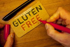 Writing note showing Gluten Free. Business photos showcasing Diet with products not containing ingredients like wheatMan creating. Writing note showing Gluten stock photos