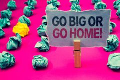 Writing note showing Go Big Or Go Home Motivational Call. Business photo showcasing Mindset Ambitious Impulse Persistence Emerald. Paper balls yellow lump rosy royalty free stock photo