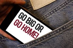 Writing note showing Go Big Or Go Home Motivational Call. Business photo showcasing Mindset Ambitious Impulse Persistence Human h. And bring out cell phone with royalty free stock photography