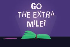 Writing note showing Go The Extra Mile. Business photo showcasing Give an additional do more than is expected from you. Color Pages of Book on Table with Pen royalty free illustration