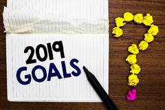 Writing note showing 2019 Goals. Business photo showcasing A plan to do for something new and better for the coming year Notebook. Marker crumpled paper forming royalty free stock photo