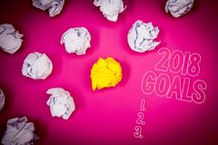 Writing note showing 2018 Goals 1. 2. 3.. Business photo showcasing Resolution Organize Beginnings Future Plans Pink ground white. Paper lumps shadow yellow lob royalty free stock photography
