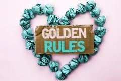 Writing note showing  Golden Rules. Business photo showcasing Regulation Principles Core Purpose Plan Norm Policy Statement writte. N Tear Cardboard Plain Royalty Free Stock Photo