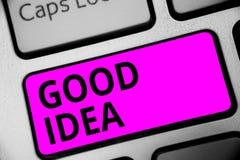 Writing note showing Good Idea. Business photo showcasing State of human brain to bring great intelegence towards something Keyboa. Rd purple key Intention royalty free stock photo