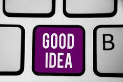 Writing note showing Good Idea. Business photo showcasing State of human brain to bring great intelegence towards something Keyboa. Rd purple key Intention stock photography