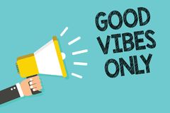 Writing note showing Good Vibes Only. Business photo showcasing Just positive emotions feelings No negative energies Man holding m. Egaphone loudspeaker blue Stock Images