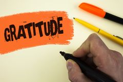 Writing note showing  Gratitude. Business photo showcasing Quality of being thankful Appreciation Thankfulness Acknowledge written. By Man holding Marker Royalty Free Stock Photography