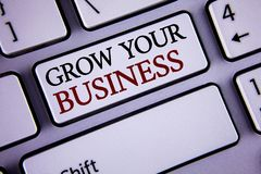 Writing note showing  Grow Your Business. Business photo showcasing improve your work enlarge company overcome competitors written. White keyboard key with copy Royalty Free Stock Image