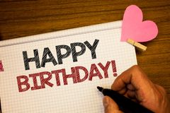 Writing note showing Happy Birthday Motivational Call. Business photo showcasing Congratulations Celebrating Anniversary Man hold. Ing pen ideas notebook pink royalty free stock photos