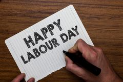 Writing note showing Happy Labour Day. Business photo showcasing annual holiday to celebrate the achievements of workers Man hold. Ing marker notebook paper stock photo