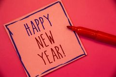 Writing note showing Happy New Year Motivational Call. Business photo showcasing Greeting Celebrating Holiday Fresh Start Ideas c. Oncepts intentions on pink stock photo