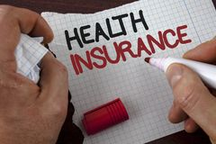 Writing note showing  Health Insurance. Business photo showcasing Health insurance information coverage healthcare provider writte. N by Man Tear Notebook paper Stock Image