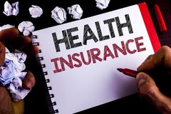 Writing note showing Health Insurance. Business photo showcasing Health insurance information coverage healthcare provider writte. N by Man Notepad holding royalty free stock photo