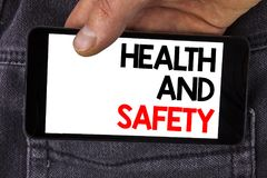Writing note showing  Health And Safety. Business photo showcasing being in good condition harmless Workouts Healthy food written. Mobile Phone Screen holding Royalty Free Stock Image