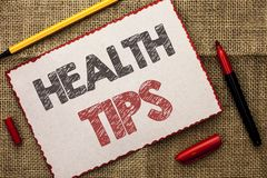 Writing note showing Health Tips. Business photo showcasing Healthy Suggestions Suggest Information Guidance Tip Idea written on. Writing note showing Health stock photos