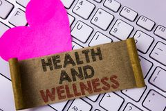Writing note showing  Health And Wellness. Business photo showcasing being in good shape Healthy food workout drink water written. Folded Cardboard Paper Piece Stock Photo