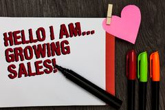Writing note showing Hello I Am... Growing Sales. Business photo showcasing Making more money Selling larger quantities Bold red w. Ords pen on page small heart royalty free stock photo