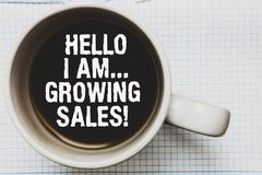 Writing note showing Hello I Am... Growing Sales. Business photo showcasing Making more money Selling larger quantities Coffee mug. With black coffee floating stock images