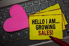 Writing note showing Hello I Am... Growing Sales. Business photo showcasing Making more money Selling larger quantities Red border. Ed yellow written paper pinch royalty free stock image