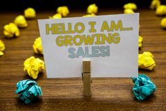 Writing note showing Hello I Am... Growing Sales. Business photo showcasing Making more money Selling larger quantities Written no. Tepad stand with paperclip royalty free stock photos