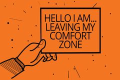 Writing note showing Hello I Am... Leaving My Comfort Zone. Business photo showcasing Making big changes Evolution Growth Man hand. Holding paper communicating royalty free illustration
