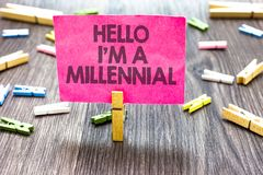 Writing note showing Hello I am A Millennial. Business photo showcasing person reaching young adulthood in current. Century Multiple clips woody table small stock images