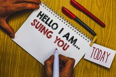 Writing note showing Hello I Am... Suing You. Business photo showcasing create a case to accuse someone from his actions Man holdi. Ng marker notebook clothepin Royalty Free Stock Photos