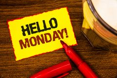 Writing note showing Hello Monday Motivational Call. Business photo showcasing Positive Message for a new day Week Start Words ye. Llow paper note red border royalty free stock photos
