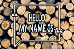 Writing note showing Hello My Name Is. Business photo showcasing meeting someone new Introduction Interview Presentation Wooden. Background vintage wood wild stock photo