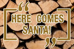 Writing note showing Here Comes Santa. Business photo showcasing Christmas song written and performed by Gene Autry. Wooden background vintage wood wild message stock photography