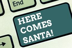Writing note showing Here Comes Santa. Business photo showcasing Christmas song written and performed by Gene Autry. Keyboard key Intention to create computer royalty free stock image
