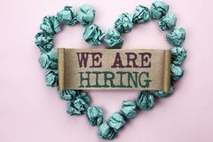 Writing note showing  We Are Hiring. Business photo showcasing Talent Hunting Job Position Wanted Workforce HR Recruitment written. Cardboard Piece Heart the Royalty Free Stock Photo