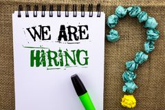 Writing note showing  We Are Hiring. Business photo showcasing Talent Hunting Job Position Wanted Workforce HR Recruitment written. Notebook Book the jute Royalty Free Stock Photo