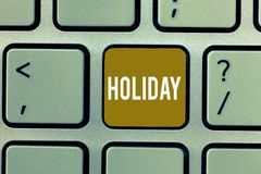 Writing note showing Holiday. Business photo showcasing Extended period of leisure recreation Vacation Celebration days.  stock photography