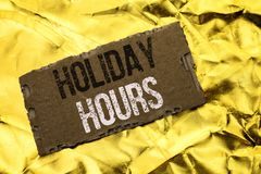 Writing note showing Holiday Hours. Business photo showcasing Celebration Time Seasonal Midnight Sales Extra-Time Opening written. Tear Cardboard Piece the royalty free stock images