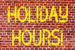 Writing note showing Holiday Hours. Business photo showcasing Celebration Time Seasonal Midnight Sales ExtraTime Opening Brick. Wall art like Graffiti stock image