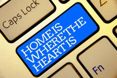 Writing note showing Home Is When The Heart Is. Business photo showcasing Your house is where you feel comfortable and happy Golde. N color computer keyboard stock photo