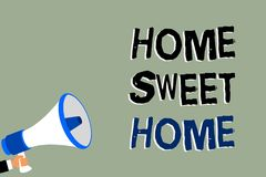 Writing note showing Home Sweet Home. Business photo showcasing In house finally Comfortable feeling Relaxed Family time Man holdi. Ng megaphone loudspeaker royalty free stock photos