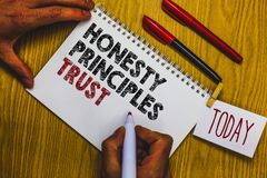 Writing note showing Honesty Principles Trust. Business photo showcasing believing someone words for granted Telling truth Man hol stock photo