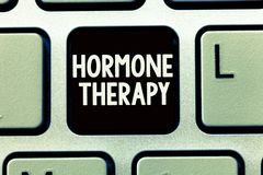 Writing note showing Hormone Therapy. Business photo showcasing use of hormones in treating of menopausal symptoms.  royalty free stock photography