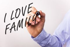 Writing note showing I Love Family. Business photos showcasing Good feelings Affection Carefulness for your mother father. Writing note showing I Love Family royalty free stock photo