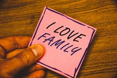 Writing note showing I Love Family. Business photos showcasing Good feelings Affection Carefulness for your mother father. Writing note showing I Love Family stock images