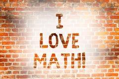 Writing note showing I Love Math. Business photo showcasing To like a lot doing calculations mathematics number geek. Demonstrating Brick Wall art like Graffiti royalty free stock image