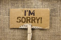 Writing note showing  I m Sorry. Business photo showcasing Apologize Conscience Feel Regretful Apologetic Repentant Sorrowful writ. Ten Cardboard Piece Holding Stock Photos