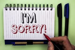 Writing note showing  I m Sorry. Business photo showcasing Apologize Conscience Feel Regretful Apologetic Repentant Sorrowful writ. Ten by Man Holding Marker Royalty Free Stock Photography