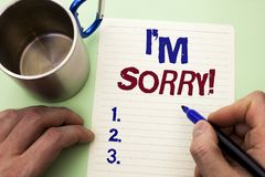 Writing note showing  I m Sorry. Business photo showcasing Apologize Conscience Feel Regretful Apologetic Repentant Sorrowful writ. Ten by Man Notebook Paper Stock Images