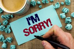 Writing note showing I m Sorry. Business photo showcasing Apologize Conscience Feel Regretful Apologetic Repentant Sorrowful writ. Ten by Man Holding Pen Sticky Royalty Free Stock Photo