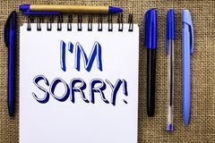 Writing note showing  I m Sorry. Business photo showcasing Apologize Conscience Feel Regretful Apologetic Repentant Sorrowful writ. Ten Notebook Book the jute Royalty Free Stock Photography