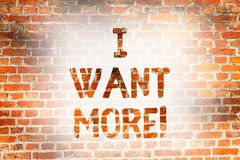 Writing note showing I Want More. Business photo showcasing Not having enough of something bigger challenges. Requirements Brick Wall art like Graffiti stock photos