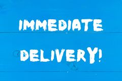 Writing note showing Immediate Delivery. Business photo showcasing Send it Now Custom Procedure to dispose Promptly royalty free stock image